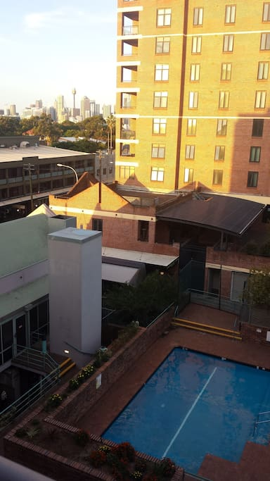 Balcony area overlooking the Sydney CBD and complex swimming pool