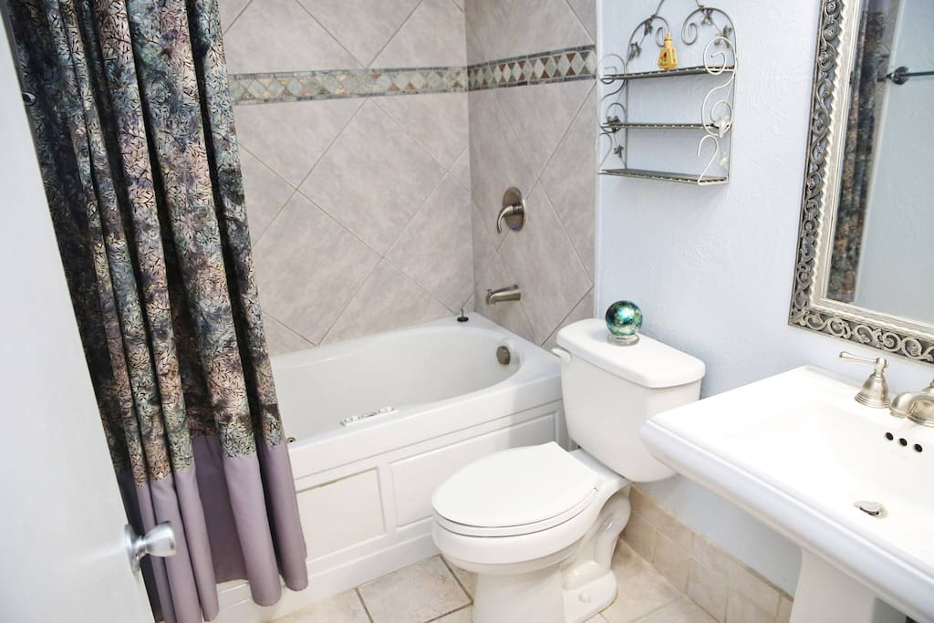 """Full private bathroom with """"Jacuzzi"""" style bath tub/shower."""