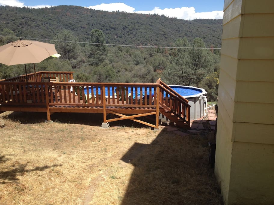 Beautiful above ground pool with deck to enjoy the views.