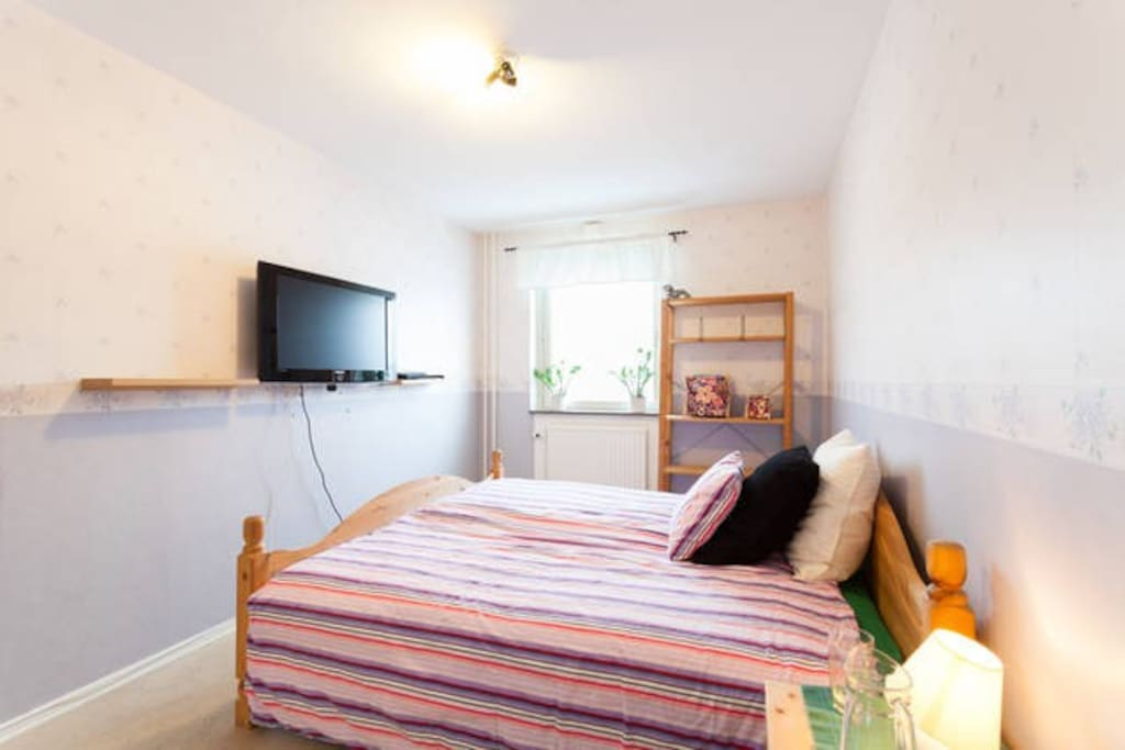 Private bedroom with double bed in shared apartment