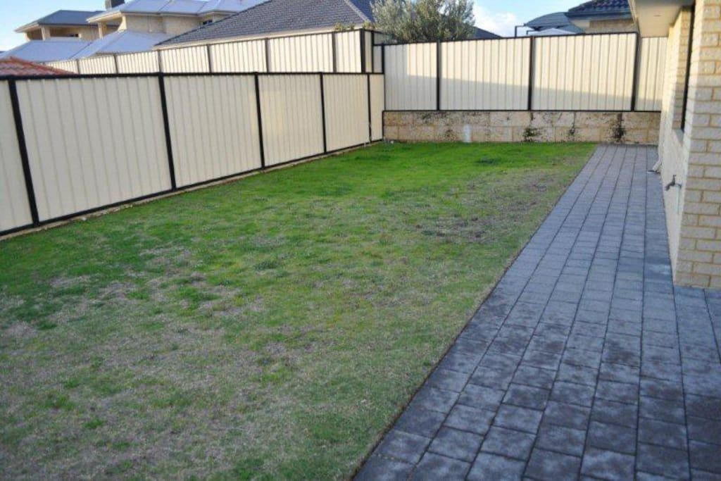 Large back yard for running and playing and patio with outdoor set to relax.  Gas BBQ provided.