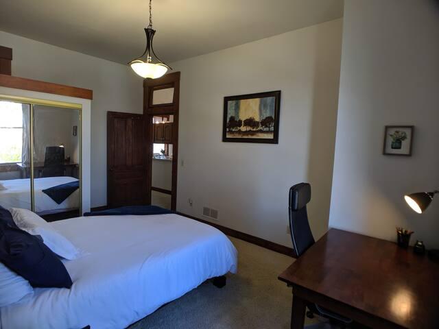 Bedroom #2 - Queen bed with work desk & closet space.