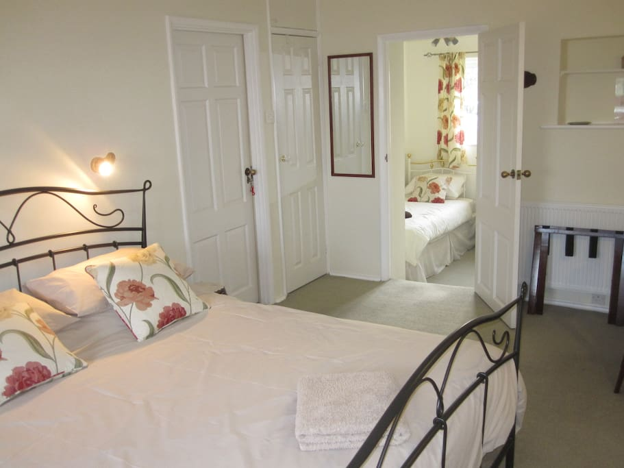 Ground floor family room which sleeps up to four persons with adjoining single bedroom and en-suite bathroom.