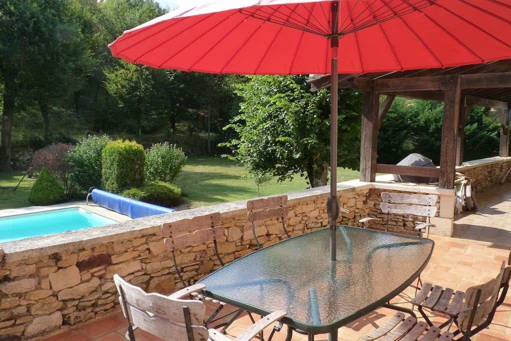 Terrace overlooking the Leat and pool, half covered half open.