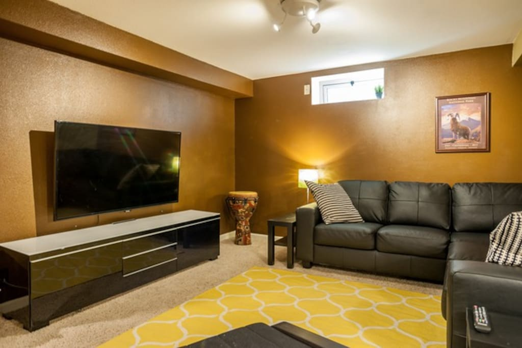 """Comfy lounge area with 60"""" TV"""