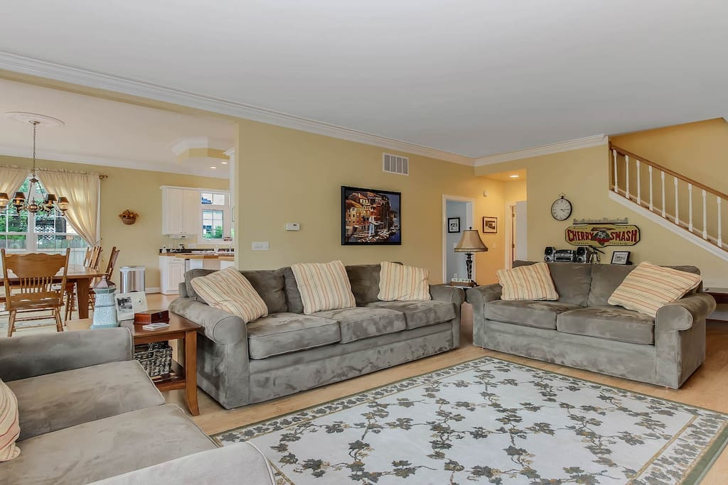 Comfortably furnished with three sofas.