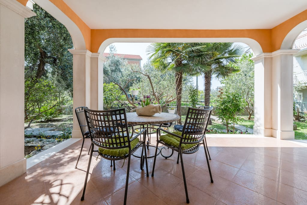 Ground floor terrace surrounded with the garden