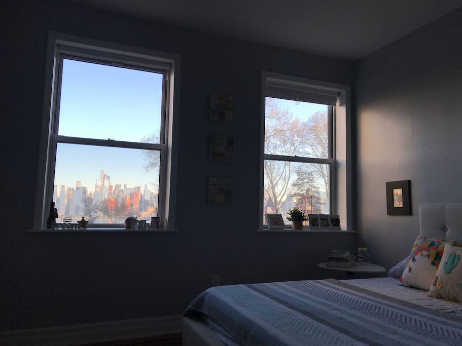 View of NYC skyline, both windows have blackout blinds