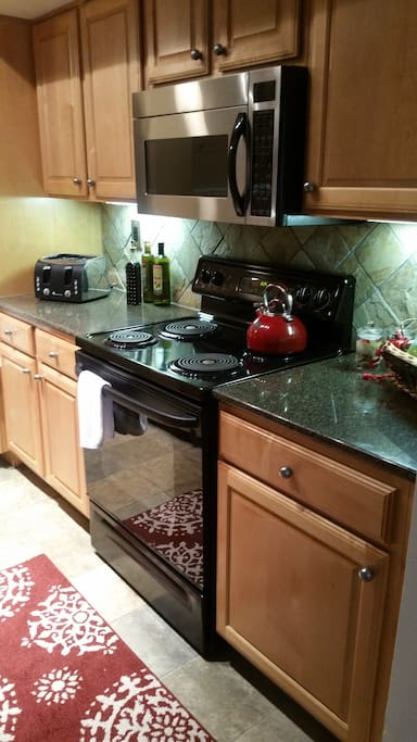 well-equipped kitchen with coffee maker and a variety of Teas.