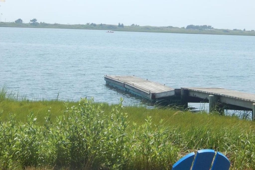 Your view of Lewis Pond from our back yard in Summer time. Sea Gull Beach is in the background.