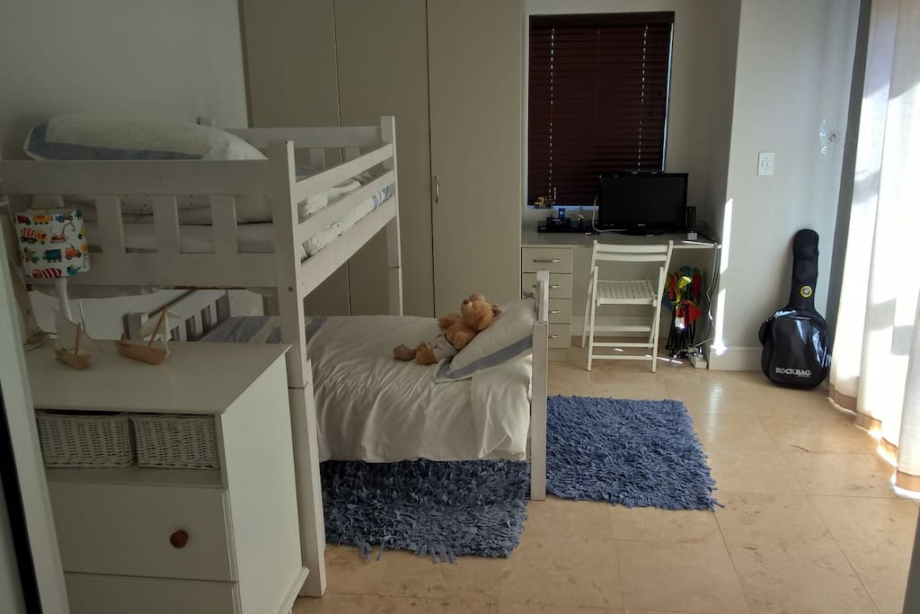 Spacious kids room leading out onto the pool area