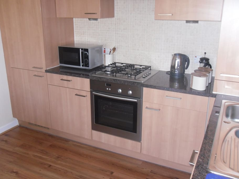 Kitchen Area - integrated fridge freezer, dishwasher and washing machine. Cooker, oven and microwave.