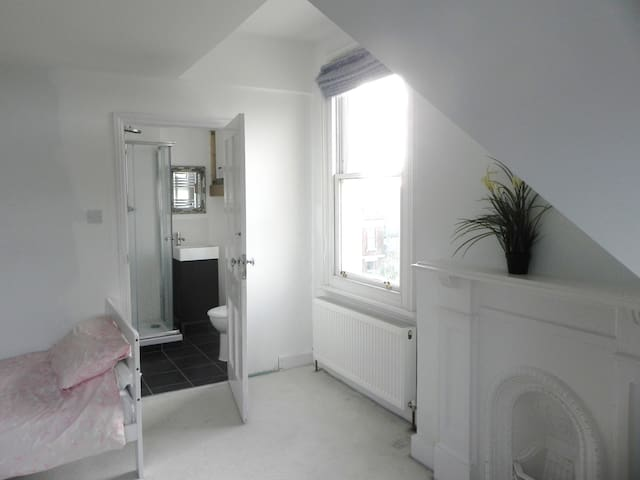The two top bedrooms share a Jack and Jill bathroom. They have seaviews