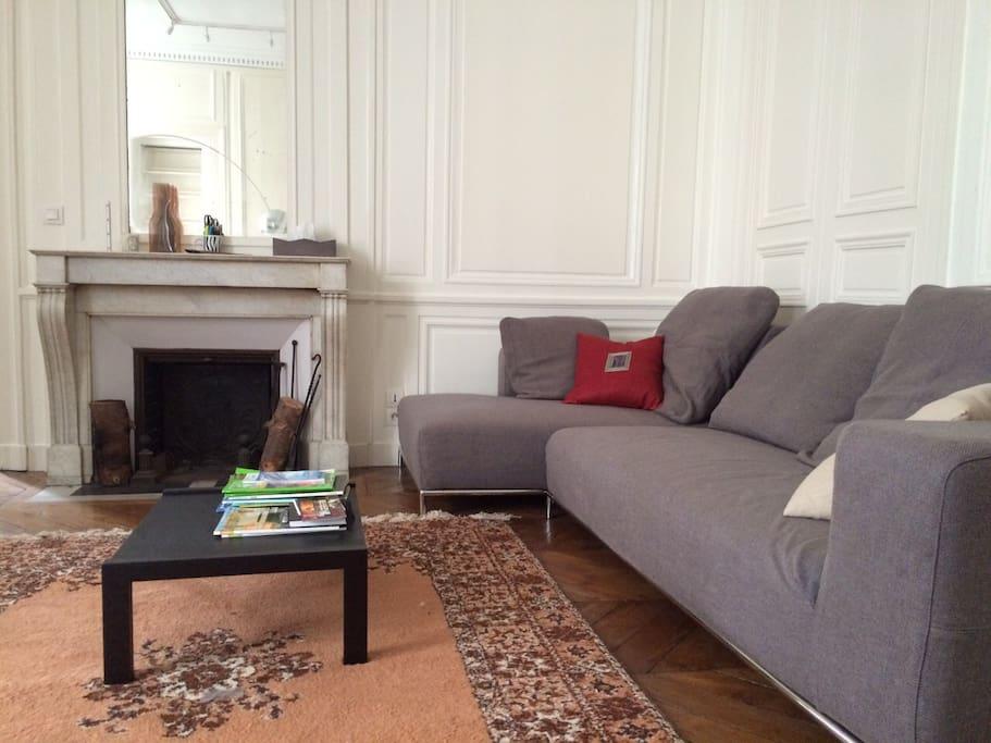 Large sofa facing big TV flat screen