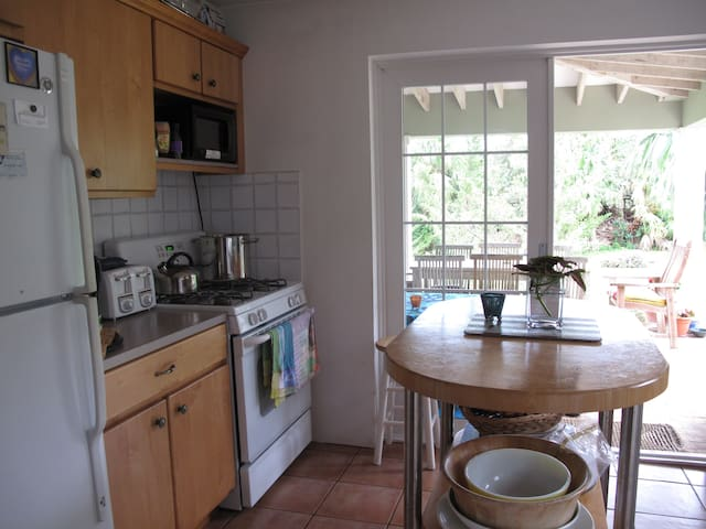 Full kitchen opens out to covered porch