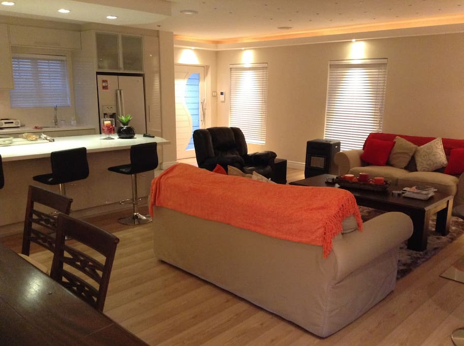 Living area with its user friendly open plan designer kitchen