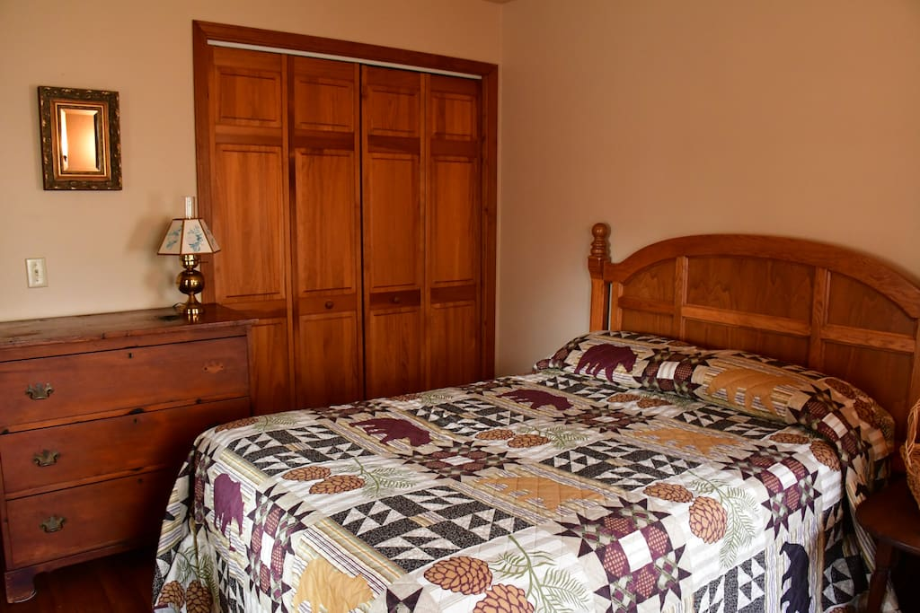 Main floor bedroom,double bed, 3 windows to porch or woods
