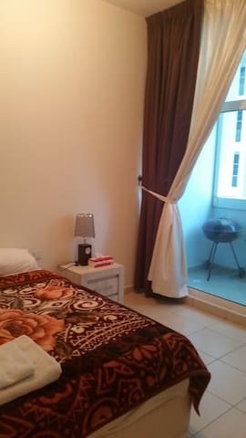 Comfortable master bedroom w/balcon close to Dubai - Ajman