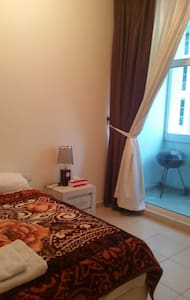 Comfortable master bedroom w/balcon close to Dubai - Ajman