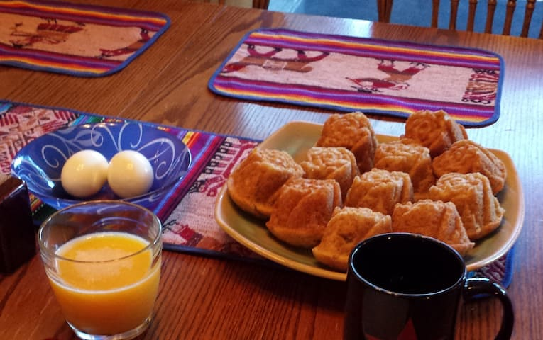 Home-baked muffins, organic hard-boiled eggs, OJ, coffee/tea