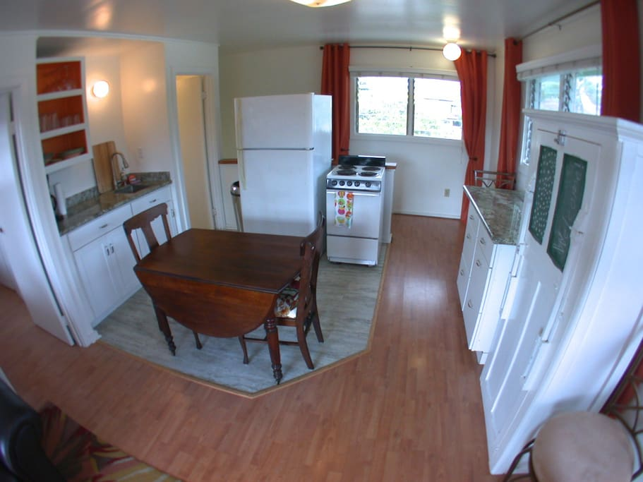 Updated, fully equipped eat-in kitchen with granite counters with spectacular views of the Ko'olau Mountains