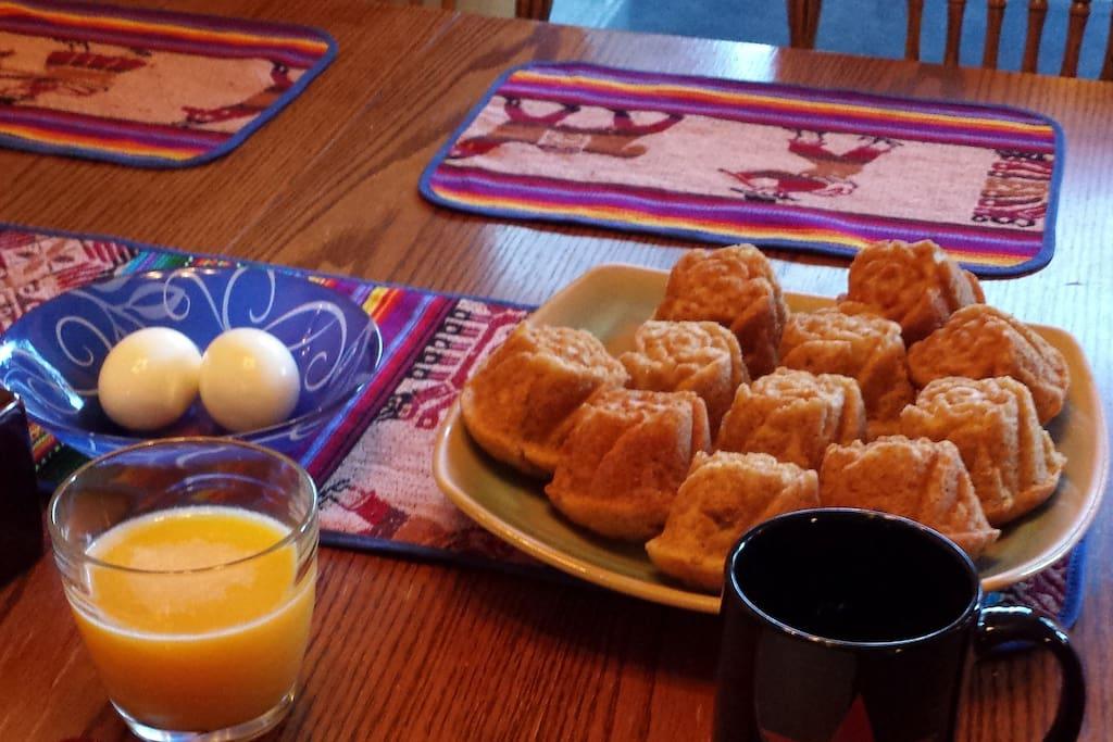 Fresh baked muffins, organic hard boiled eggs, OJ, coffee, tea in morning