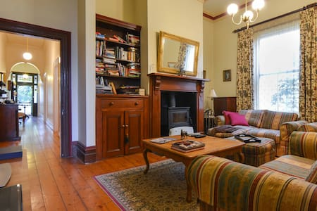 Lovely period cottage, classic accommodation in historic village style suburb. 500 metres to Railway Station, 23 minutes to city. My Goldie comes at no extra cost! Breakfast provisions supplied. House is yours during the day MON to FRI. Easy parking.