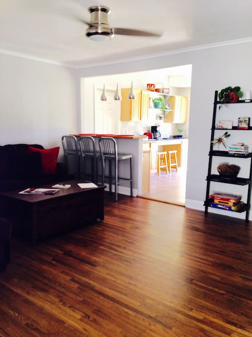 Gracious living space with a corner couch, large flat screen and lots of comfort.