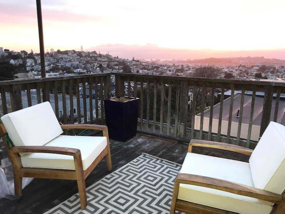 Step onto the large private deck from bed for a sunrise over the Bay.