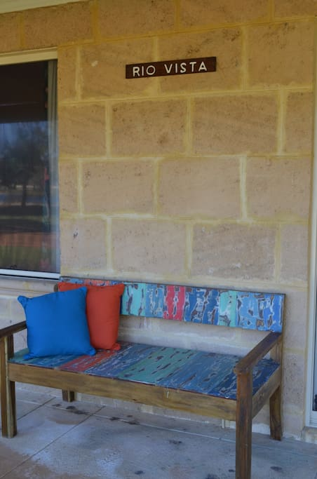 Enjoy the river views from the bench on the front verandah.