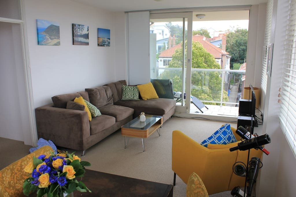 Large living and dining area with panoramic views of Bondi and large sliding door to the balcony.