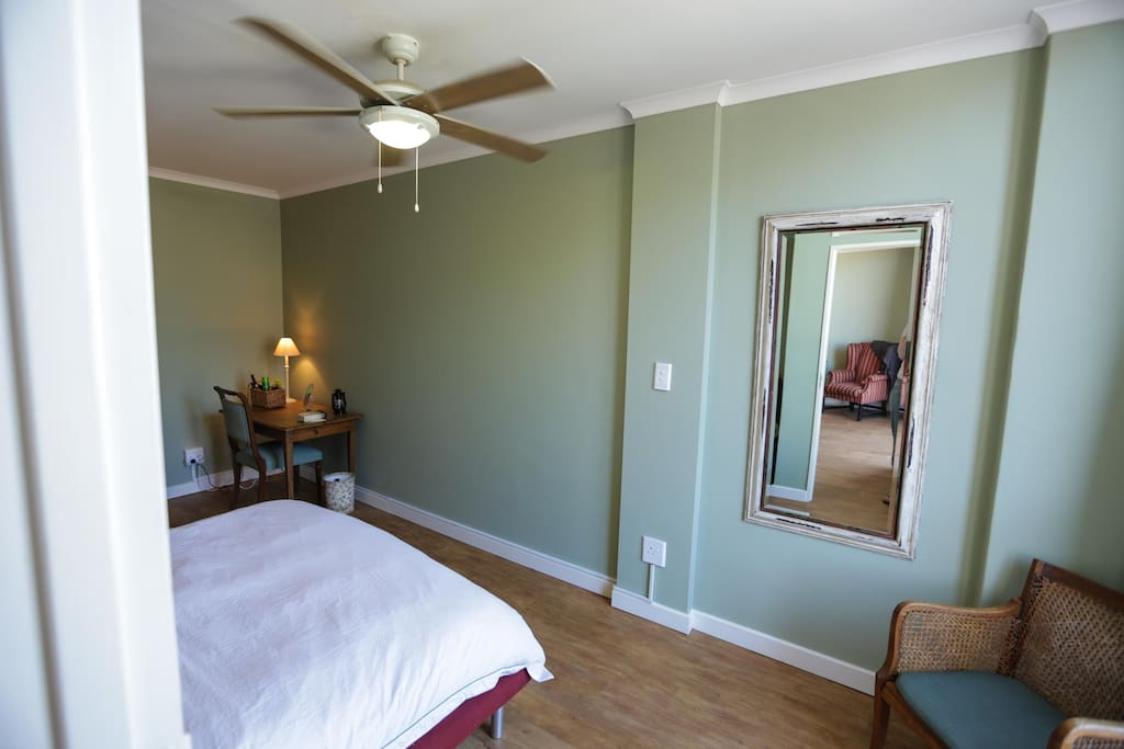 Bedroom with queen sized bed and crisp white linen, changed weekly.