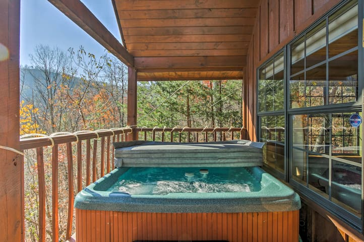 This 2-bed, 2-bath vacation rental cabin boasts 2 balconies & a private hot tub!