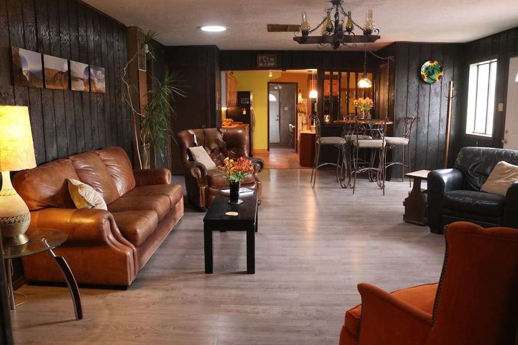 The living room, beyond is the kitchen & dining/game room