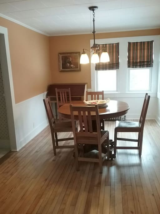 Newly redecorated dining room has table that will seat 8.
