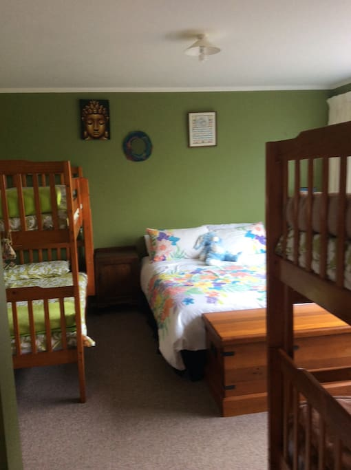 One only bedroom with queen bed and two sets of bunk beds.