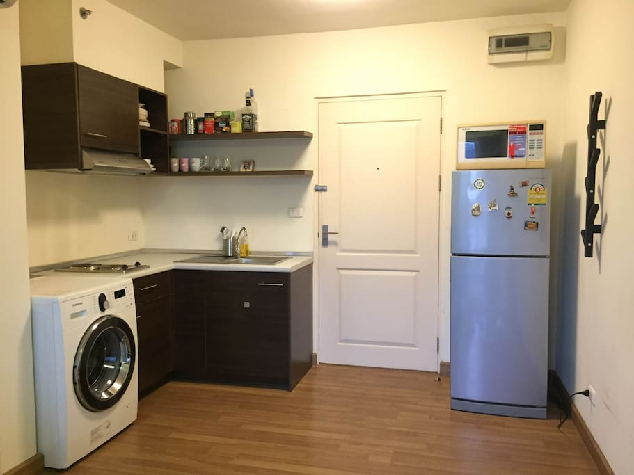 Kitchen area with cooking equipment, washing machine (Free of Charge)