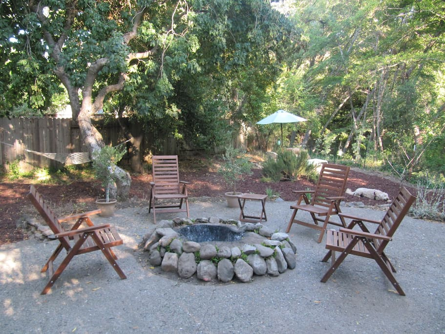 Fire ring and backyard lounging areas