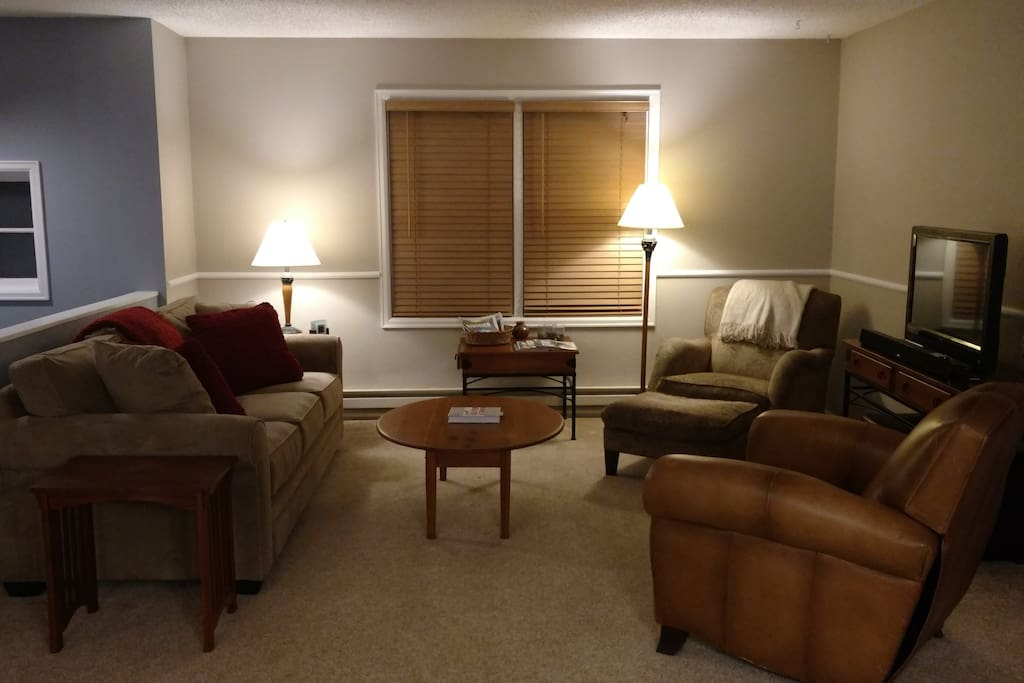 Spacious, comfortable upper level living room - flows to dining room and kitchen
