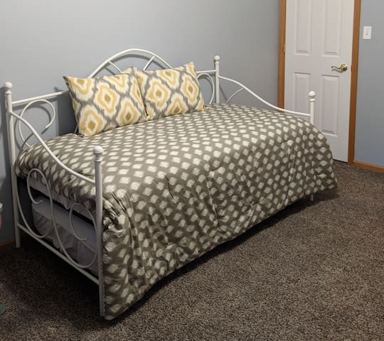Twin daybed with a trundle bed, sleeps two.