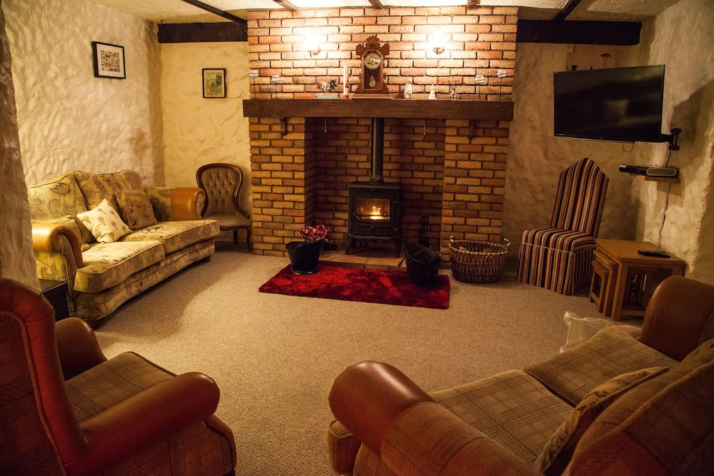 Cosy living room with wood-burning stove