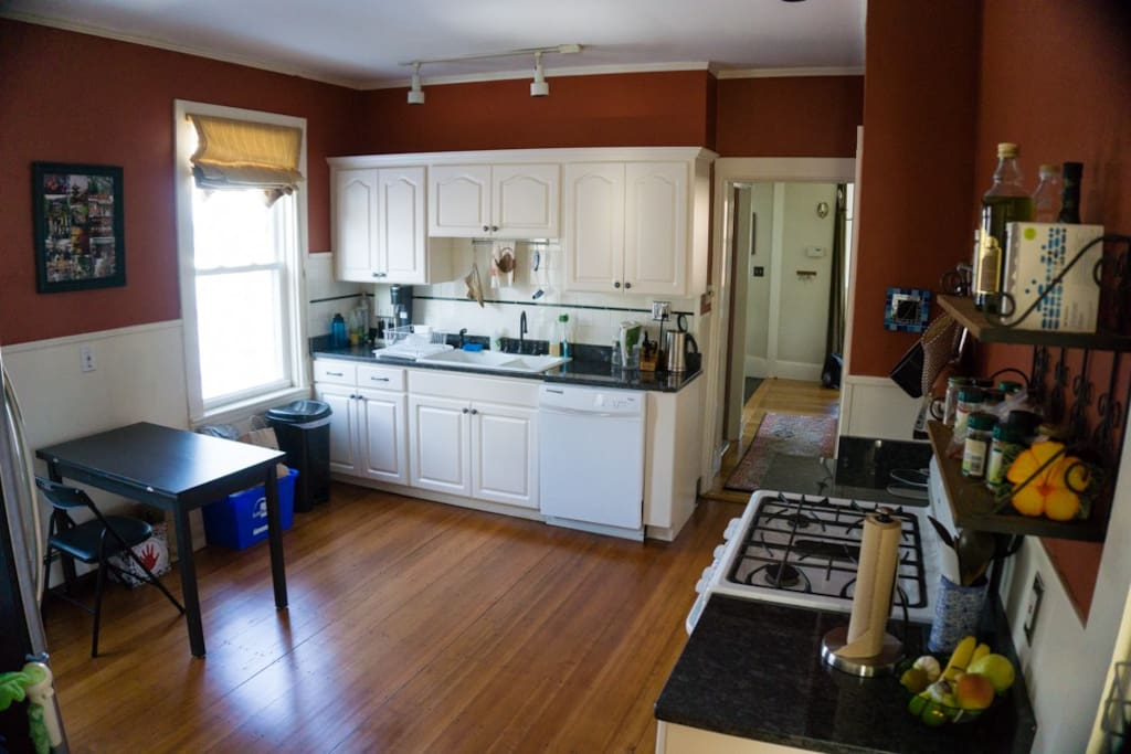 The kitchen has granite countertops and appliances galore.