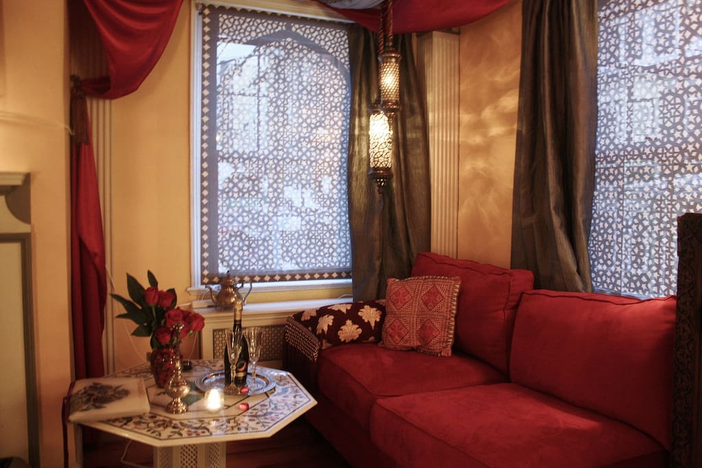 Sitting alcove with Turkish pendant lamps and Moorish interlace panels, silk drapes