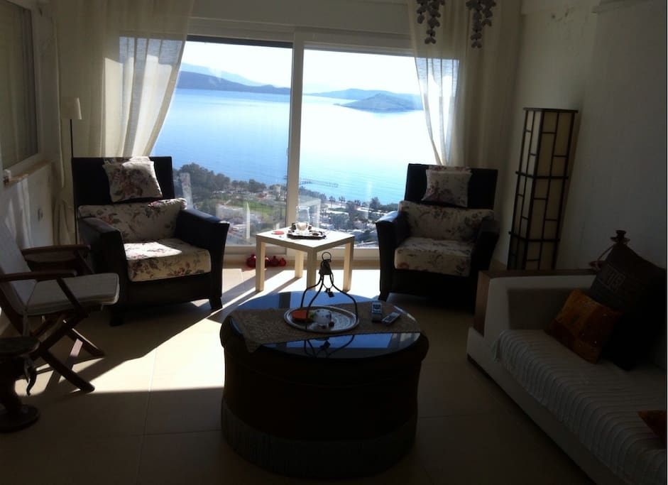 Living room, connected open kitchen and a big Balcony with magnificient sea view..