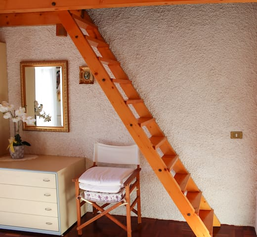 This steep stair leads to the attic, where you can find the second room.