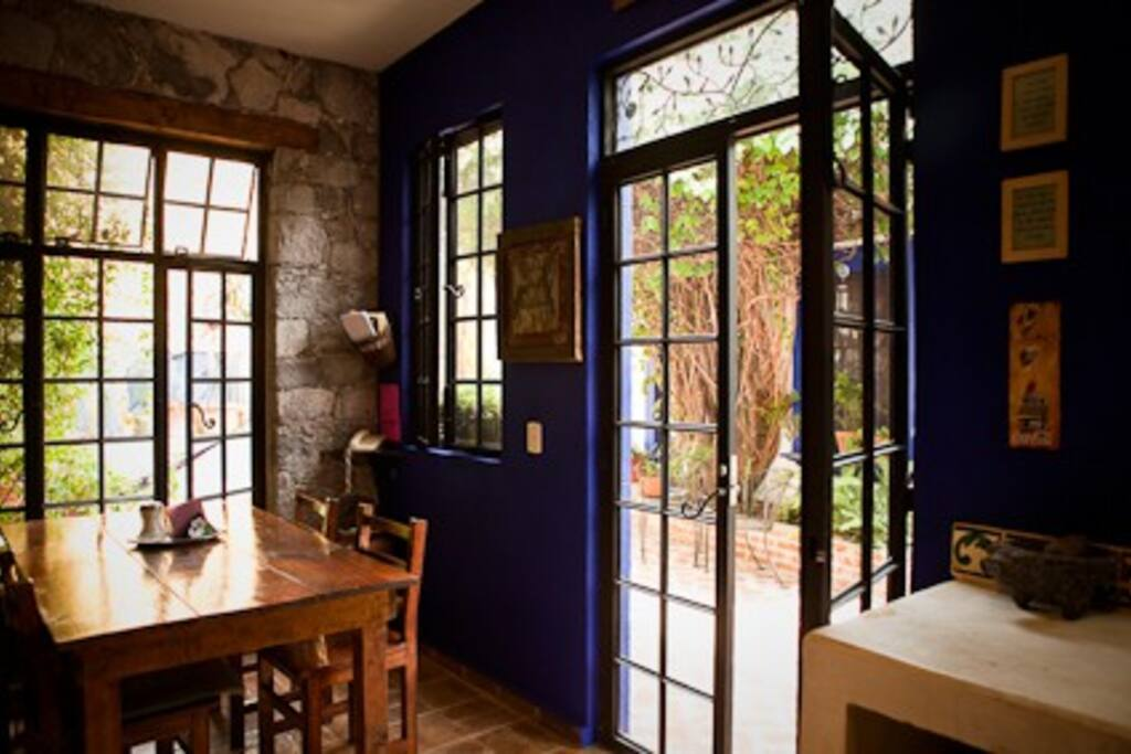 the kitchen and dining area at Casita de las Flores San Miguel de Allende
