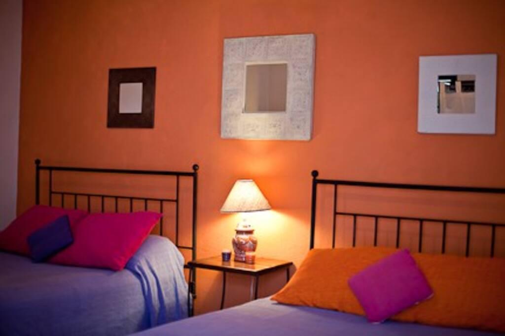 the orange room at Casita de las Flores San Miguel de Allende