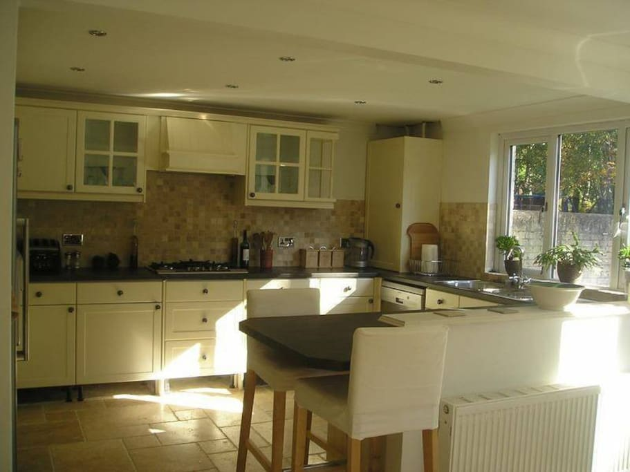 Kitchen with modern amenities and seating area