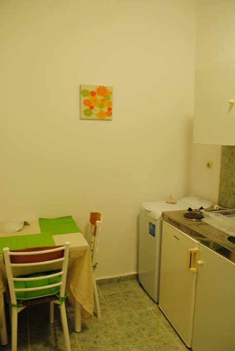 The room is actually a fully equiped small apartment.. Kitchenette, washing machine, fridge...