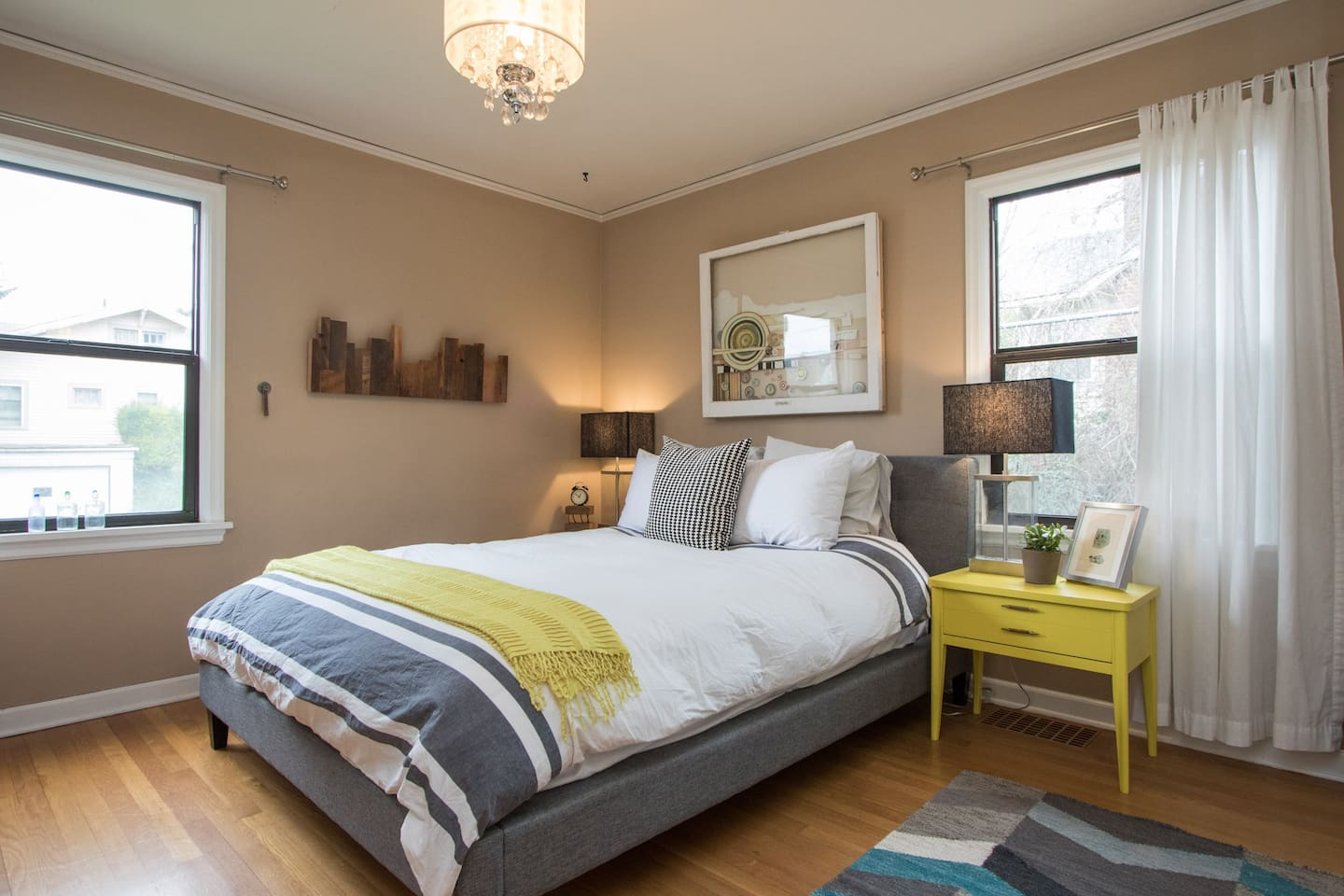 Lots of light and Lux Appointments Give This Room a Modern  and Approachable Feel